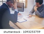 Small photo of Businessman as boss blaming and admonish his employee for business mistake at desk in office