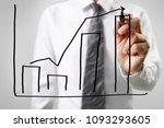 businessman drawing graphics a... | Shutterstock . vector #1093293605