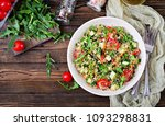 Stock photo salads with quinoa arugula radish tomatoes and cucumber in bowl on wooden background healthy 1093298831