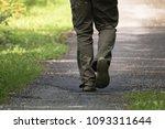 back view man's feet walking... | Shutterstock . vector #1093311644