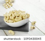 cashew nuts is used in most... | Shutterstock . vector #1093430045