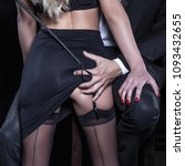 Small photo of Man with whip grab sub woman lovers ass concept, closeup