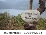 "Small photo of A rock with the message of 'Everything is annicca"". Annicca means impermanence in Pali language."