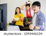 people watch football game.... | Shutterstock . vector #1093446134