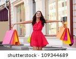 happy woman walking with... | Shutterstock . vector #109344689