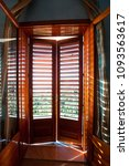 closed wooden shutters on... | Shutterstock . vector #1093563617