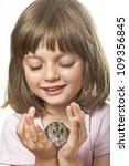 Little Girl Holding Hamster He...
