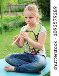 portrait of little girl playing ...   Shutterstock . vector #1093579289
