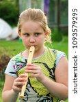 portrait of little girl playing ...   Shutterstock . vector #1093579295