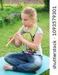portrait of little girl playing ...   Shutterstock . vector #1093579301