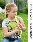 portrait of little girl playing ...   Shutterstock . vector #1093579319