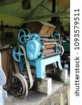 Small photo of Piece of antique belt driven farm machinery which was powered by a steam engine.