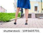 beautiful women's feet in shoes ... | Shutterstock . vector #1093605701