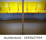 empty yellow seat behind the... | Shutterstock . vector #1093627454
