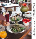 fresh green zucchini noodle... | Shutterstock . vector #1093633994