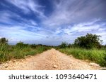 dusty road in the old village... | Shutterstock . vector #1093640471