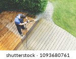 man cleaning terrace with a... | Shutterstock . vector #1093680761