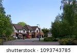 a quiet suburban cul de sac... | Shutterstock . vector #1093743785