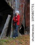 elderly woman poses besides her ...   Shutterstock . vector #1093807751