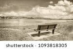 a lonely bench in a quay near... | Shutterstock . vector #1093818305