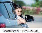 a woman driving a car in reverse | Shutterstock . vector #1093823831
