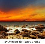 Red Sky Over A Rocky Seashore....