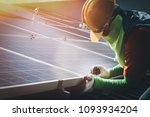 installing a solar cell on a... | Shutterstock . vector #1093934204