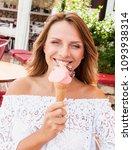 beautiful blond woman eat... | Shutterstock . vector #1093938314
