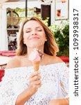 beautiful blond woman eat... | Shutterstock . vector #1093938317