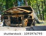 burnt out car fire | Shutterstock . vector #1093976795