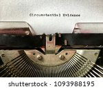 Small photo of Circumstantial Evidence heading typed in black ink on white paper on manual vintage typewriter
