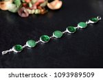 green resin bracelet on a dark... | Shutterstock . vector #1093989509