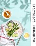 asparagus salad served on sunny ... | Shutterstock . vector #1094017364