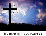 wooden crucifix of jesus on the ...   Shutterstock . vector #1094020511