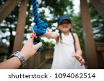 parent and child hand over the... | Shutterstock . vector #1094062514