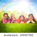 happy group of girls lying on a ... | Shutterstock . vector #109407305