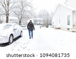 young man walking by car in... | Shutterstock . vector #1094081735