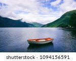 lonely boat on the lake        | Shutterstock . vector #1094156591
