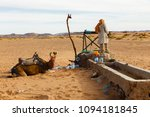 berber man with camels at the... | Shutterstock . vector #1094181845