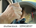 Man\'s Hand On The Steering...
