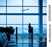 girl at the airport window and... | Shutterstock . vector #109420469
