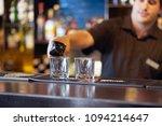 bartender man pours whiskey to... | Shutterstock . vector #1094214647