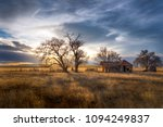 Old Farmhouse at Sunset on the Great Plains - stock photo