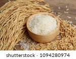 paddy and white rice | Shutterstock . vector #1094280974