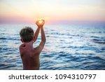 boy on the beach making a heart ... | Shutterstock . vector #1094310797