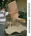 Small photo of Santiago de Chile, April 14, 2011. Chile, Process of assembling a chair model in molded tertiary.