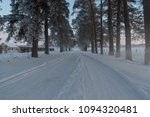 snowy forest alley in the... | Shutterstock . vector #1094320481