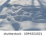 trampled white snow in the... | Shutterstock . vector #1094321021