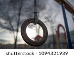 ring suspended on a rope on a... | Shutterstock . vector #1094321939