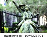 Cute Little Children statue riding on a Horse, boy and girl are together riding on a horse.